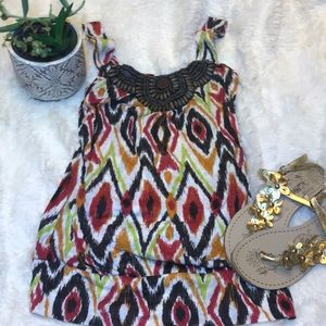Tops - Tank top with beaded accents at neck.